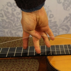 slack in guitar string