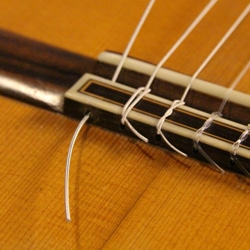 change classical guitar strings tie knot