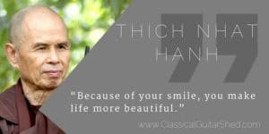 Thich Nhat Hanh smiling guitar practice