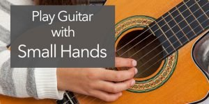 small hands on classical guitar